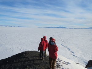 A few of ANITA folk standing out near Discovery Hut. White Island and Black island are far in the distance.