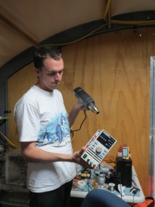 Alex warming up a power supply after it was sitting outside in the shipping container at -15 C for a couple weeks.
