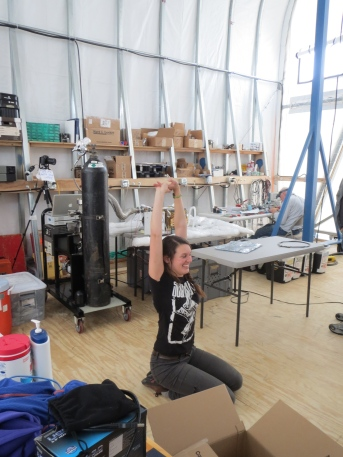 Carolyn during one of her morning stretch sessions. The carpenters building our weather port stretched every morning, and Carolyn and I often joined them. We decided to continue the tradition, and she's been doing a good job sticking to it.